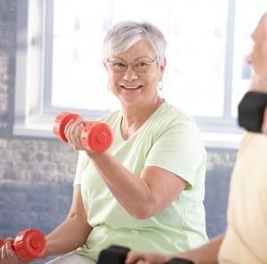 Vital senior couple in the gym